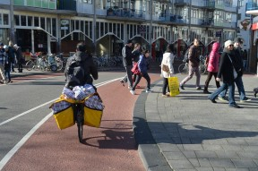 Moving luggage on a bike, central Amsterdam, mid afternoon